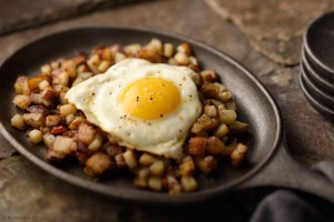 food photography of egg over potatos