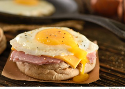 Food photographer shoots a ham egg and cheese muffin.